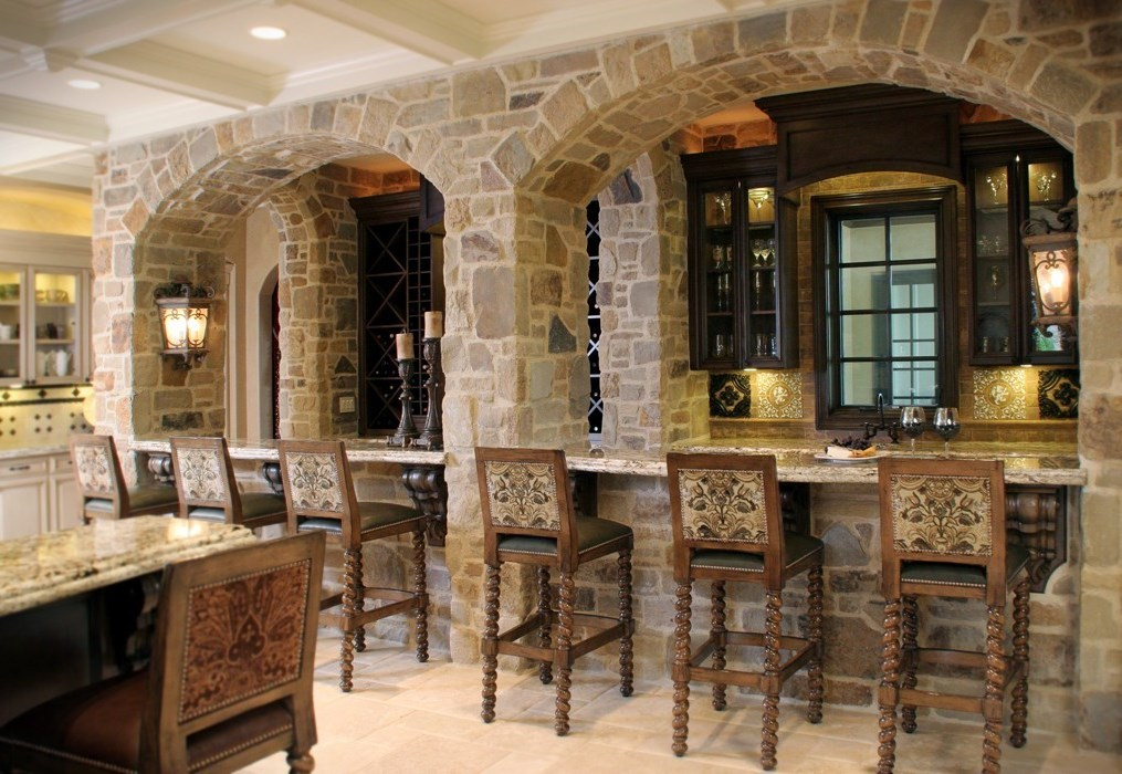 Kitchen medieval style – stone archways and antique furniture