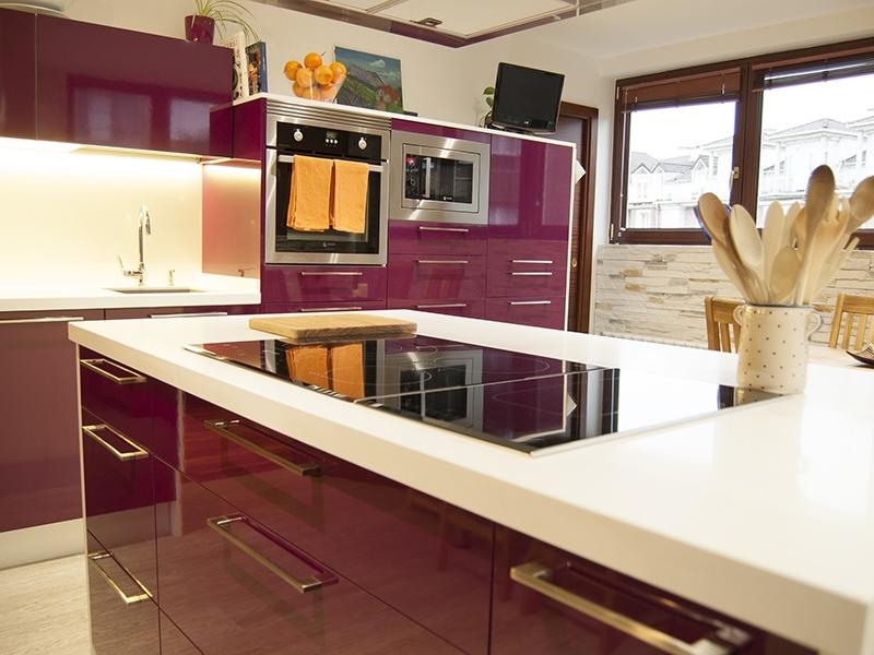 A kitchen of a bright eggplant color