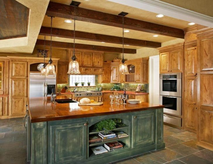 Built-in spotlights and chandelier in the interior design of the country style kitchen
