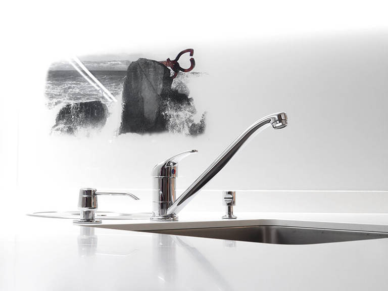 Chrome faucet in kitchen high-tech style