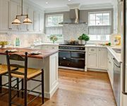 Country kitchen in bright colors - Retro lamps - black stove with hood