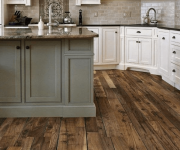 Floor of wooden planks in the kitchen in country style