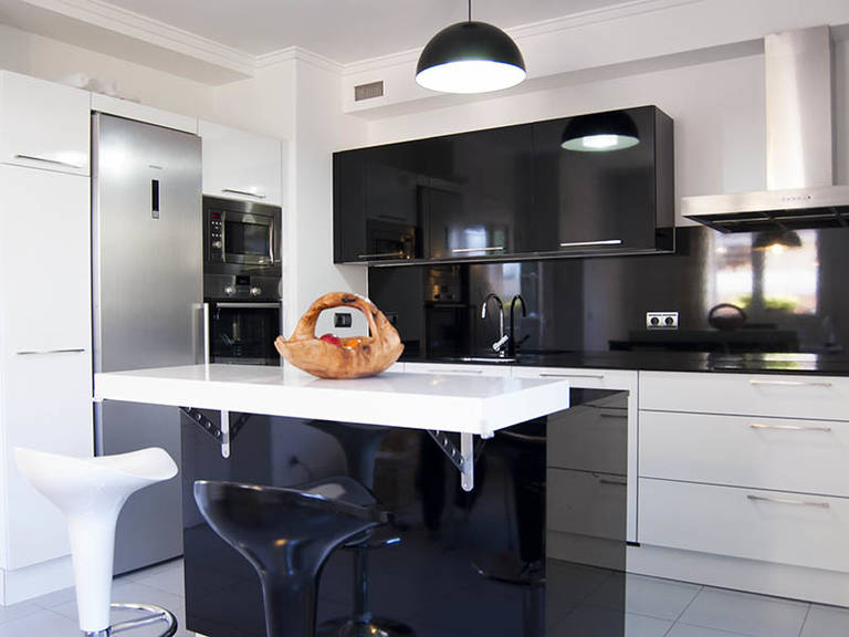 High tech kitchen design - Glossy black facades create an emphatically rigorous design