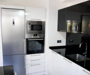 High tech kitchen design idea white and black colors 180x150 - High-Tech Kitchen