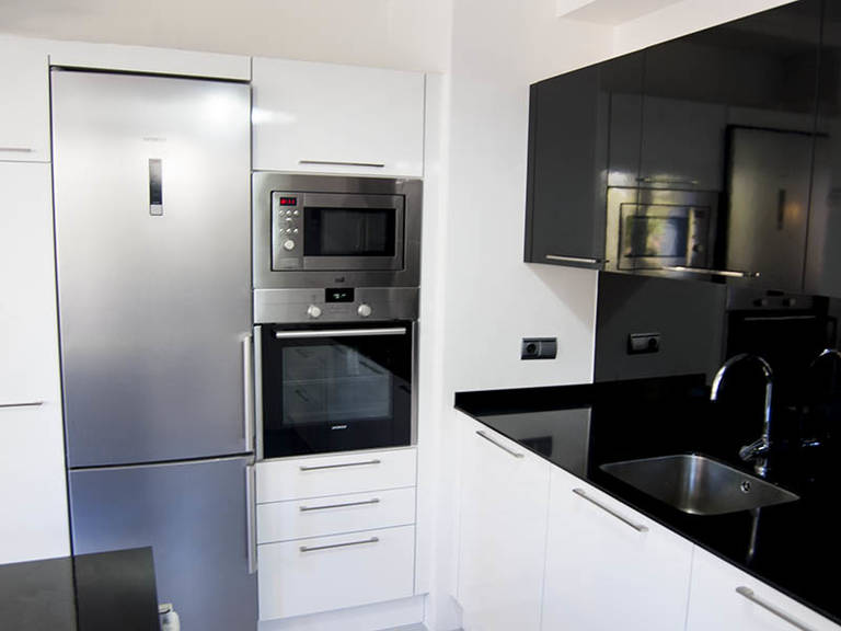 High tech kitchen design idea – white and black colors