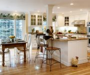 Kitchen design images - Kitchen in country style with wooden floors, wooden table, kitchen island table and bar stools