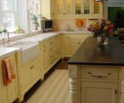 Lighting and cabinets warm colors in the kitchen in country style 180x150 - Country-Style Kitchens