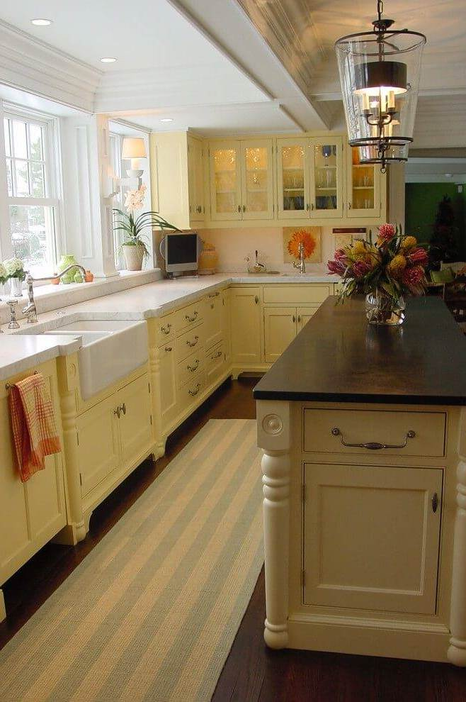 Lighting and cabinets warm colors in the kitchen in country style