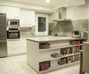 Modern Hi Tech Kitchen – The white-gray interior creates a sense of spaciousness
