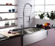 Modern faucet in the kitchen in high-tech style