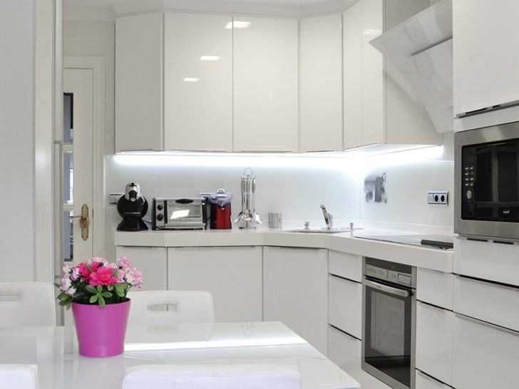 Modern white kitchen in high-tech style