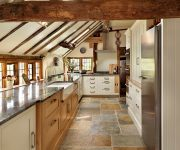 The stone floor in the kitchen in country style 180x150 - Country-Style Kitchens