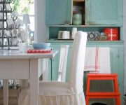 White chair covers in the kitchen in country style