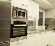 White gray interior Kitchen high tech style high tech kitchen appliances 180x150 - High-Tech Kitchen