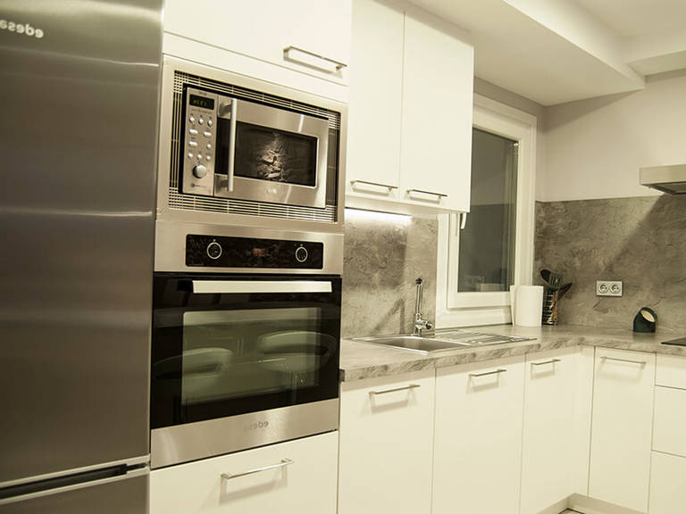 White-gray interior – Kitchen high-tech style – high tech kitchen appliances