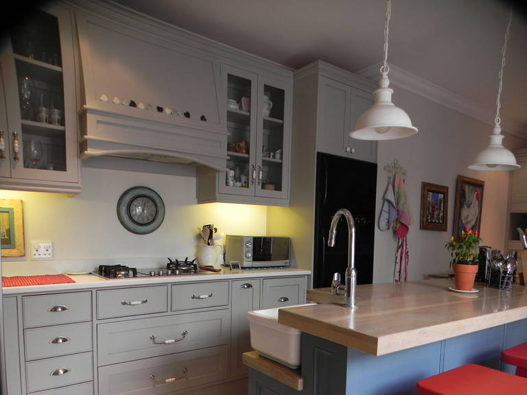White pendant lamp, Gray cabinets, countertop with sink in the kitchen in country style