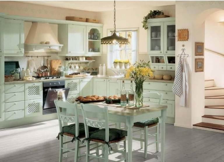 Wooden dining table, white wardrobes and chairs – kitchen furniture in country style