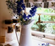 Kitchen Provence Enameled jugs and cans 180x150 - Provence Style Kitchens – 100 ideas for interior